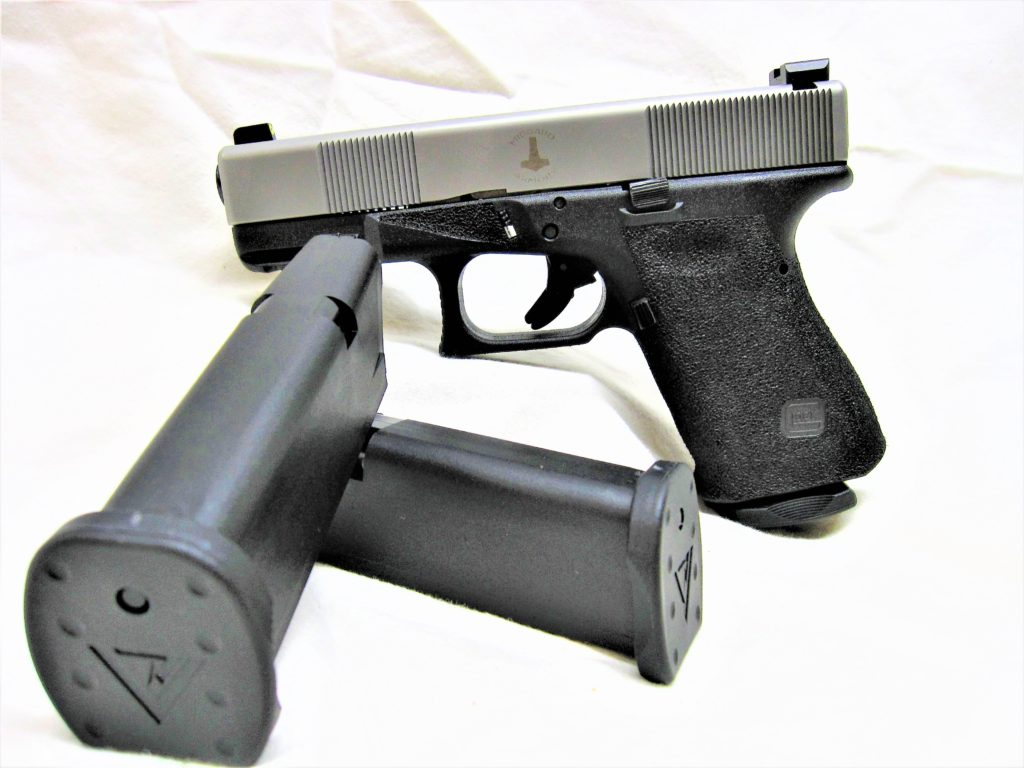 MA Glock 19 and included magazines with Vickers baseplates. Angled cut cocking serrations.