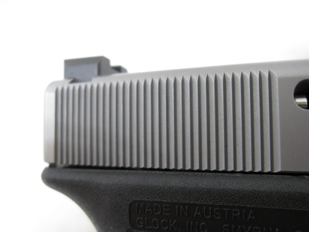 Cocking serrations on MA Glock 19 slide