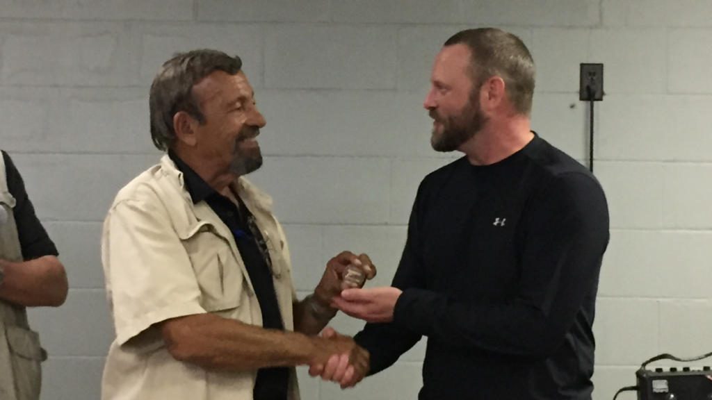 "Receiving ""Top Shooter"" coin from Massad Ayoob at MAG40, 2016"